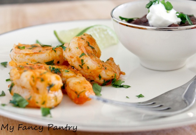 Mexican Spiced Shrimp with Black Beans topped with a dollop of Greek Yogurt
